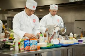 Students prepare food for the cooking contest.